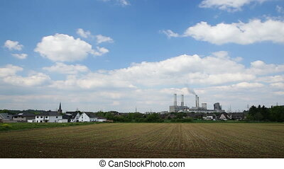 Power Station And Village Timelapse - Timelapse sequence of...