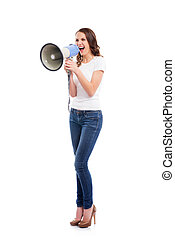 A young and attractive Caucasian woman in stylish jeans...