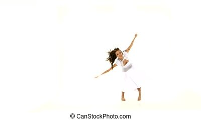 Beautiful girl in light dress dancing contemp jazz modern on white background
