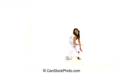 Slim young woman in light dress dancing contemp jazz modern on white background