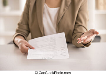Businesswoman - Close-up. Young businesswoman holding resume...