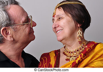 portrait of happy senior couple looking at each other