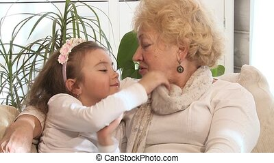 Little girl and her grandmother ind
