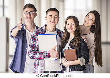 Students - Group of happy young students in a university