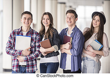 Students - Group of happy young students in a university.
