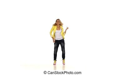 Young blond girl in yellow clothes dancing sexy-jazz on...
