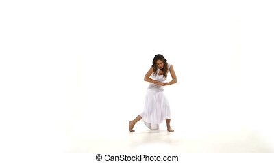 Slim young woman in light dress dancing contemp jazz modern on white background, slow motion