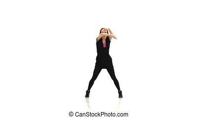Beautiful red girl in black clothes dancing jazz-funk...