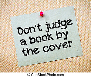 Don't judge a book by the cover Message. Recycled paper note...