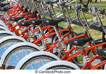 Bikes parked - many red bikes parked for public use