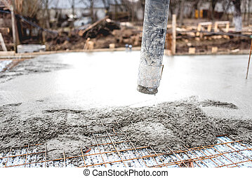 Close up of concrete automatic pump tube working on...