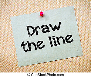 Draw the Line Message. Recycled paper note pinned on cork...