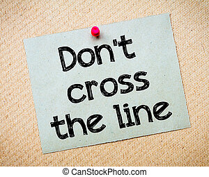 Dont cross the line Message Recycled paper note pinned on...