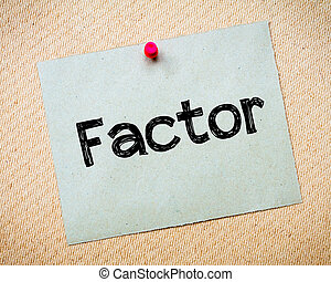 Factor Message Recycled paper note pinned on cork board...