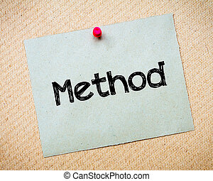 Method Message. Recycled paper note pinned on cork board....