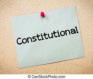 Constitutional Message Recycled paper note pinned on cork...