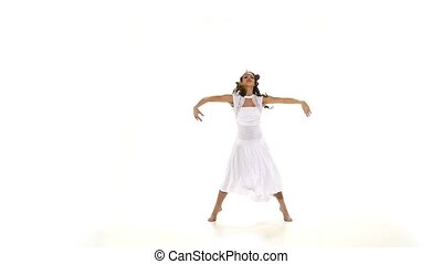 Modern style girl in light clothes dancing contemp jazz modern on white background, slow motion