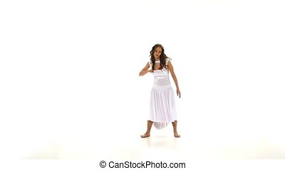 Attractive young woman in light dress dancing contemp jazz modern on white background, slow motion