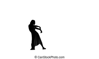 Young woman dancer in long dress dancing jazz-pop broadway jazz on white background, slow motion, silhouette