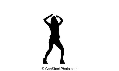 Slim young woman dancing on white background, slow motion,...