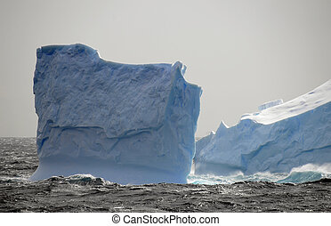 Blue iceberg in storm