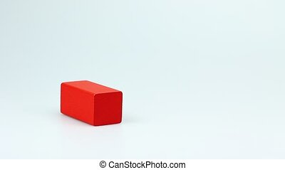wooden; cube; block; wood; toy; squ - Womans hand is...