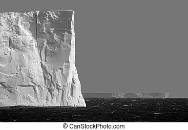 Isolated iceberg in grey