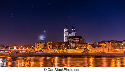 View of Cathedral of Magdeburg and the river Elbe at night...