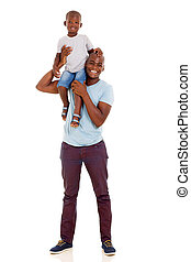 young african american man carrying son on shoulder