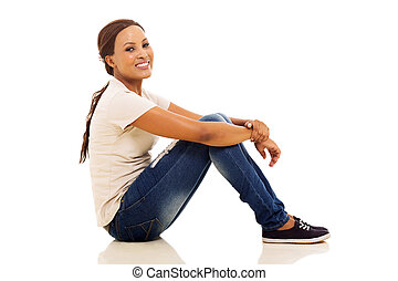 young african woman sitting on floor - happy young african...