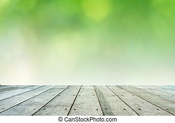 Leaf bokeh with wooden paving.