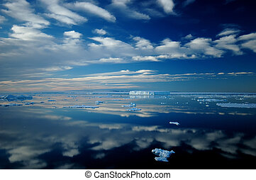 Antarctic mirror - Antarctic iceberg and cloud landscape...