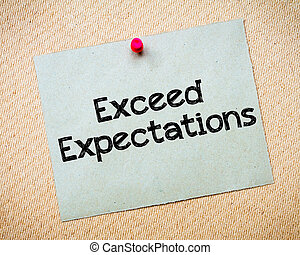 Exceed Expectations Message. Recycled paper note pinned on...