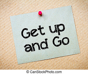 Get up and Go Message. Recycled paper note pinned on cork...