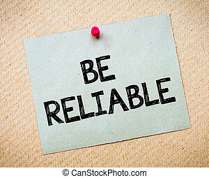 Be Reliable Message. Recycled paper note pinned on cork...