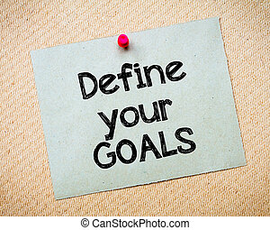 Define your GOALS Message. Recycled paper note pinned on...