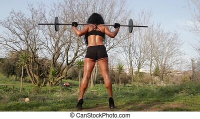Female bodybuilder - Sexy bodybuilder doing squat exercise...