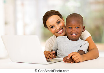 little boy and mother with laptop computer