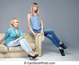 Fashion photo of two blonde woman. - Two beautiful young...