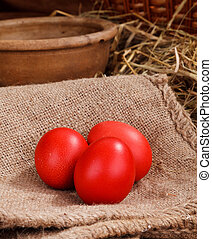 red easter eggs - three red easter eggs at home backgraund