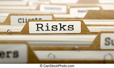 Risks Concept with Word on Folder. - Risks Concept. Word on...