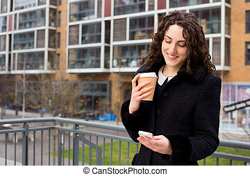 young woman reading her text messages