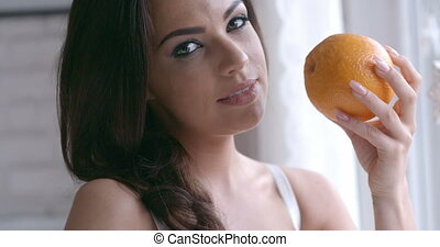 Seductive Woman Holding Fresh Orange Fruit - Close up Young...