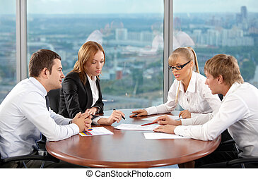 Negotiations - Four businessmen are engaged in negotiations...