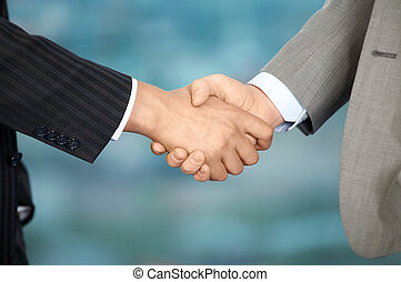 Hand shake - Two business men shake each other hands at...