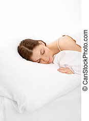 The sleeping girl - The young girl sleeps in the white bed,...