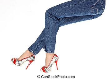 Female legs in trousers