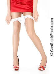 White panties and red dress - Close up of legs of the girl...