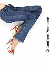 Jeans trousers - Lying female legs in the jeans trousers,...