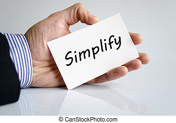 Simplify - Bussines man hand writing Simplify - business...